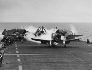Planes landing on a WWII US Navy aircraft carrier
