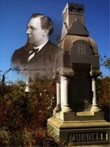 Black and white portrait of John Mundell, St. in front of his headstone