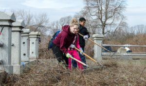 Volunteers at Mount Moriah Cemetery cleaning up a grave site