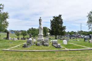 Monument and headstones at Mount Moriah Cemetery