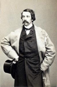 Portrait of actor Edwin Adams holding his hat