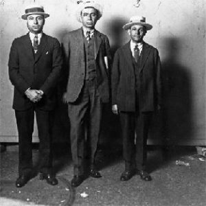 """John """"Big Nose"""" Avena, mob boss, standing with two other men"""