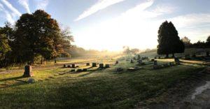 Sunrise over headstones at Mount Moriah Cemetery