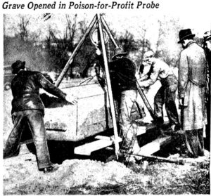 Workers opening a grave to investigate a poison-for-profit probe