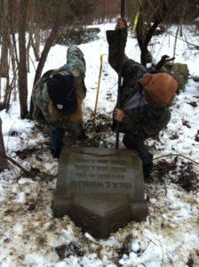 Volunteers raising Robert Emmet Winslow's headstone at Mount Moriah Cemetery